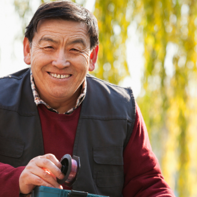 man smiling and holding a fishing rod