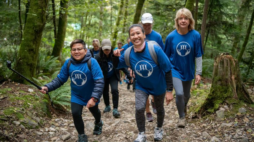 Hikers smiling as they climb Grouse Mountain in the Climb for Alzheimer's 2019.