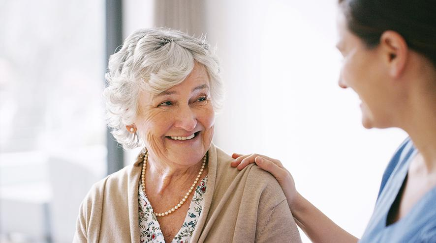 Older woman smiling at a younger woman
