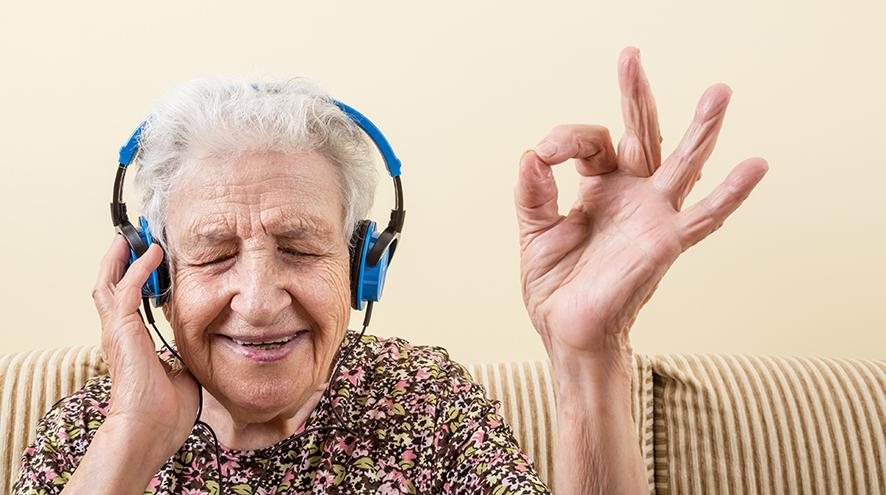 Senior woman listening to music.