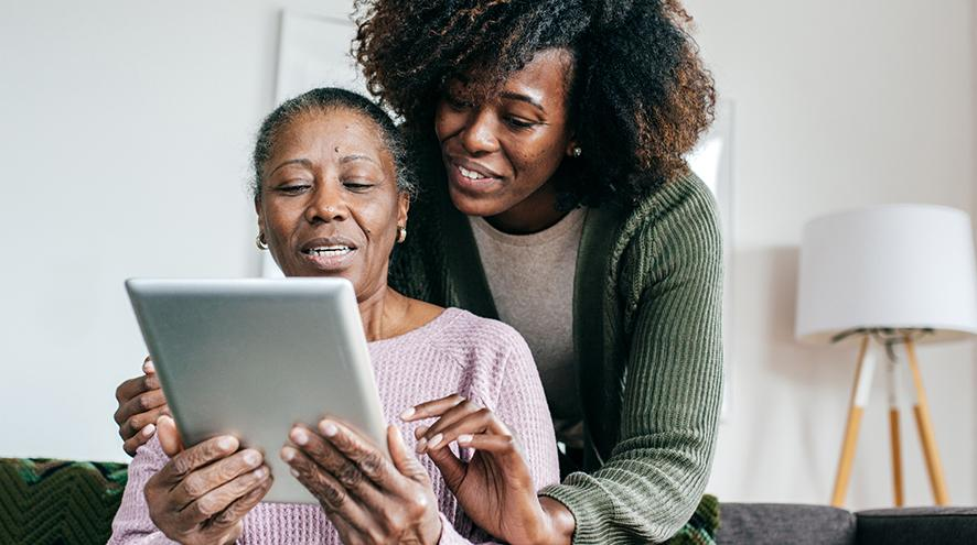 Mother and daughter using a tablet together.