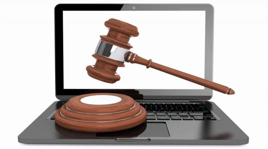 Banging an auction gavel on a laptop