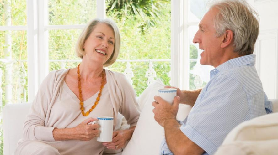 Senior couple enjoying a cup of coffee.