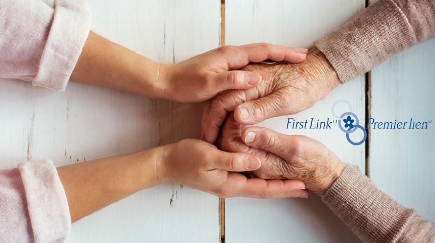 A set of hands clasping an older set of hands