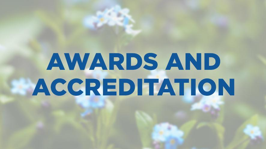 An image of Forget-Me-Not flowers in the background that says Awards and Accreditation