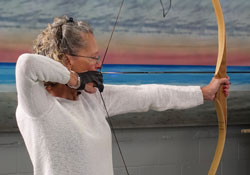 Phyllis taking aim with her bow.