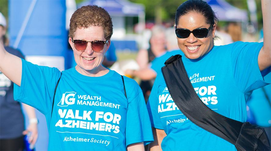 Two people participating in their local IG Wealth Management Walk for Alzheimer's.