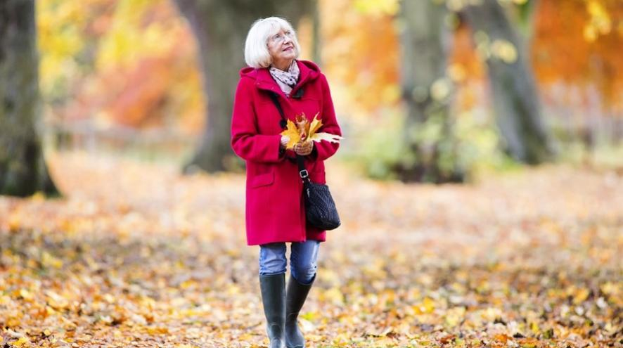 Senior woman on an autumn walk.