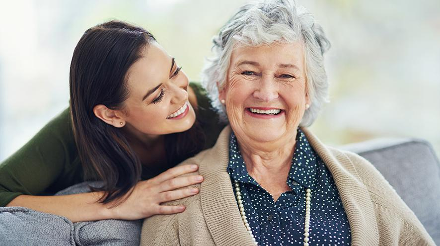 Senior woman smiling with her daughter.