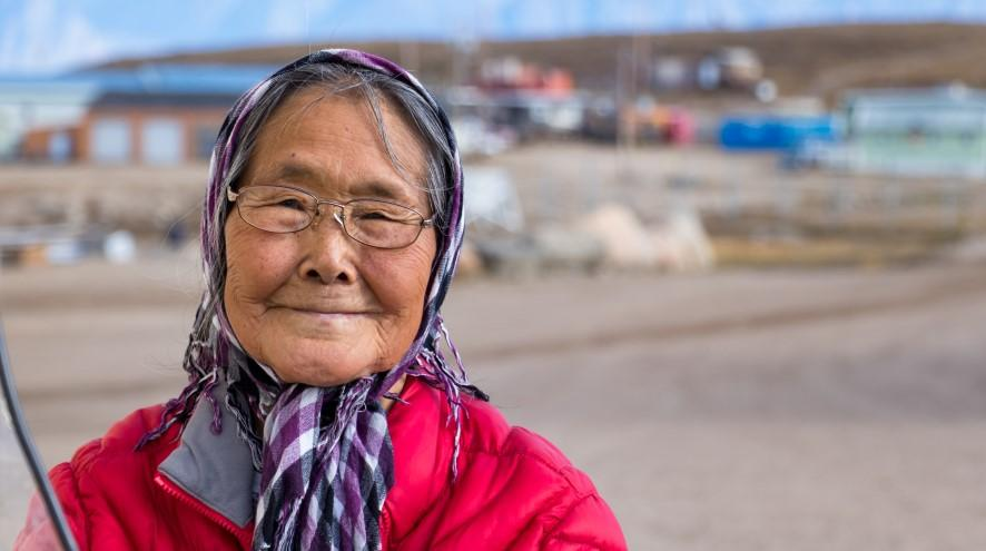 Senior woman standing in front of her town.