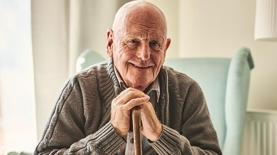 Smiling senior man at care home.