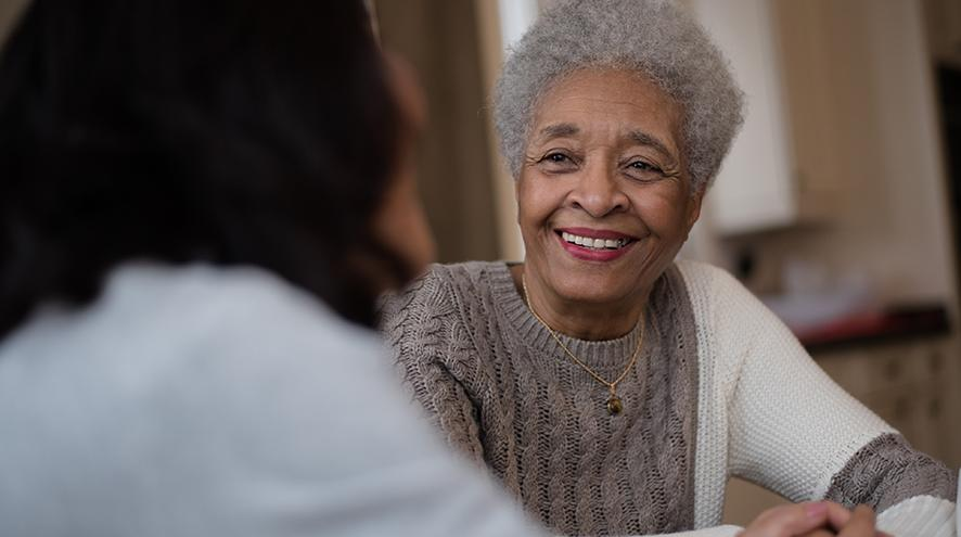 Smiling senior woman talking to her doctor.