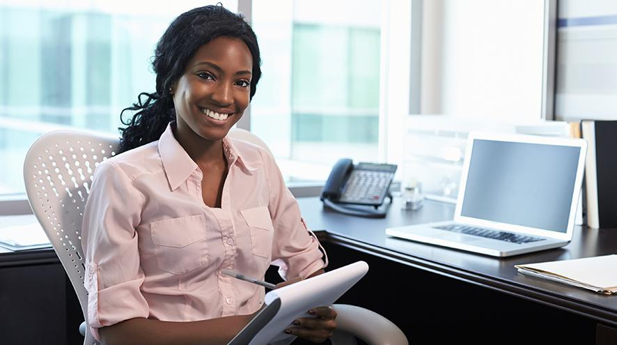 Young woman working in office.