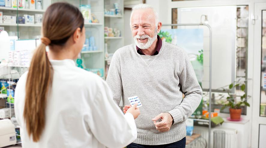 Pharmacist helping a senior client.