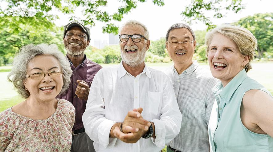 Group of happy seniors in the park.