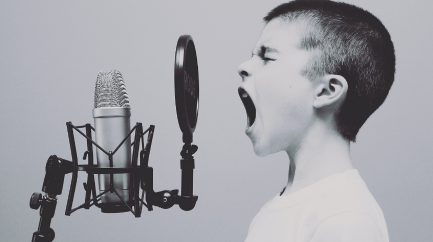 White boy shouting into a microphone