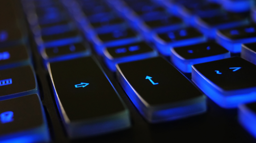 Black keyboard lit up in blue.